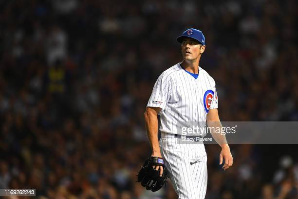 Cole Hamels of the Chicago Cubs walks to the dugout during the sixth inning against the San Francisco Giants at Wrigley Field on August 20 2019 in...