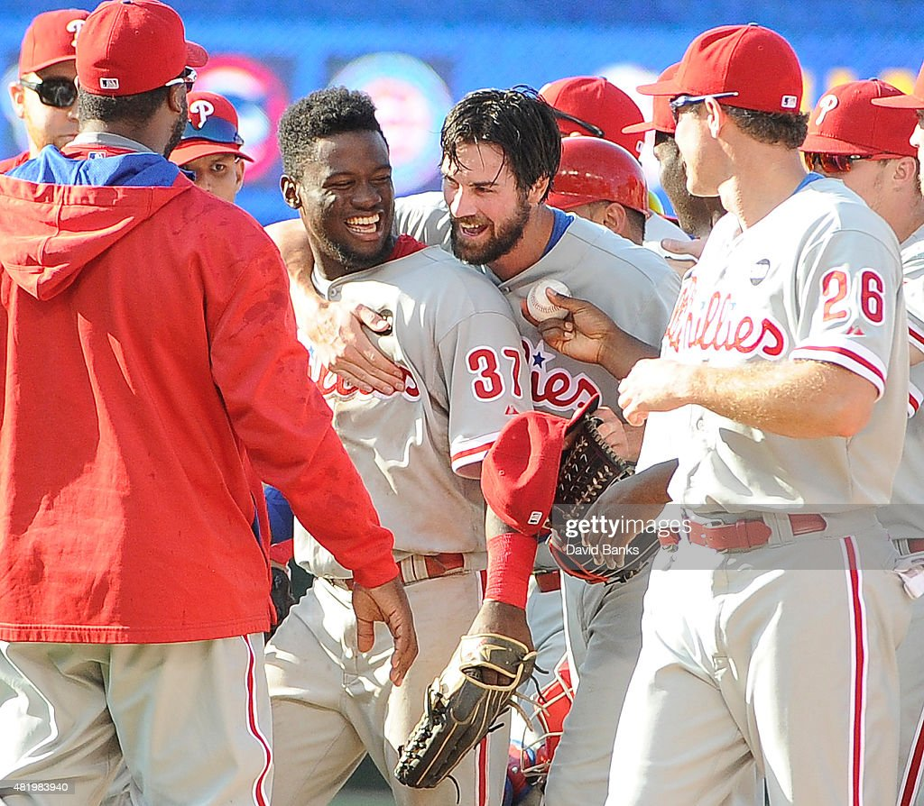 Cole Hamels #35 of the Philadelphia Phillies and Odubel Herrera #37 celebrate on July 25, 2015 at Wrigley Field in Chicago, Illinois. Cole Hamels #35 of the Philadelphia Phillies pitched a no hitter. The Phillies won 5-0.