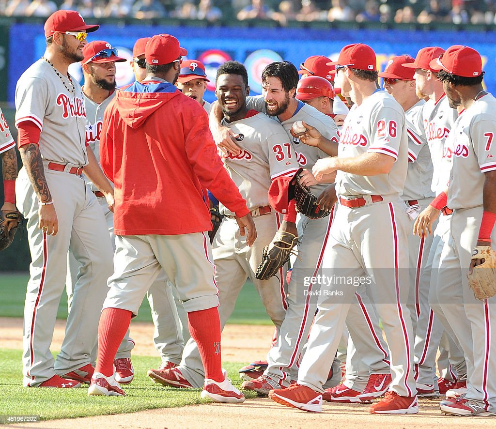 Cole Hamels #35 of the Philadelphia Phillies celebrates his no hitter with his teammates July 25, 2015 at Wrigley Field in Chicago, Illinois. Hamels pitched a no hitter and the Phillies won 5-0.