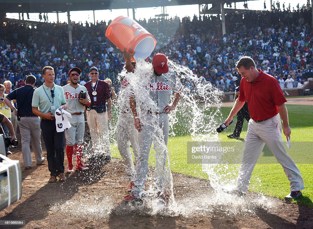Cole Hamels #35 of the Philadelphia Phillies gets a ice water bath after his no hitter on July 25, 2015 at Wrigley Field in Chicago, Illinois. Hamels pitched a no hitter and the Phillies won 5-0.
