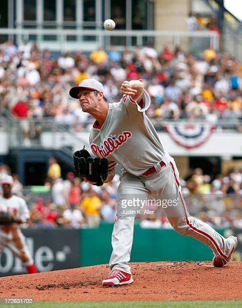 Cole Hamels of the Philadelphia Phillies pitches in the first inning against the Pittsburgh Pirates during the game on July 4 2013 at PNC Park in...