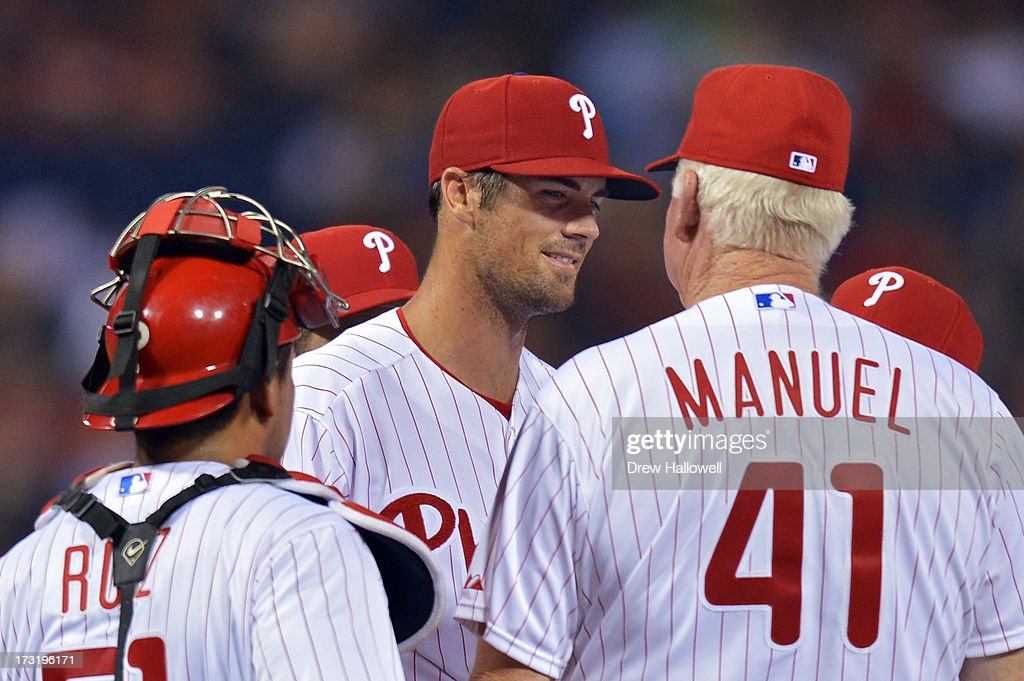 Cole Hamels #35 of the Philadelphia Phillies smiles at manager Charlie Manuel #41 during a meeting on the mound during the game against the Washington Nationals at Citizens Bank Park on July 9, 2013 in Philadelphia, Pennsylvania. The Phillies won 4-2.