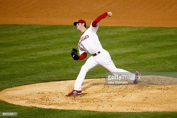 Cole Hamels of the Philadelphia Phillies throws a pitch against the Los Angeles Dodgers in Game One of the National League Championship Series during...