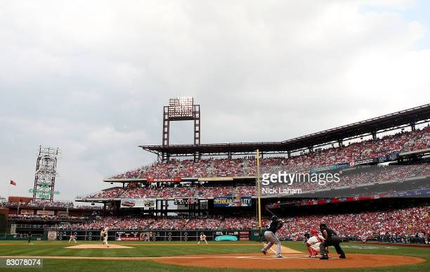 Cole Hamels of the Philadelphia Phillies throws the first pitch against the Milwaukee Brewers during Game 1 of the NLDS Playoffs at Citizens Bank...