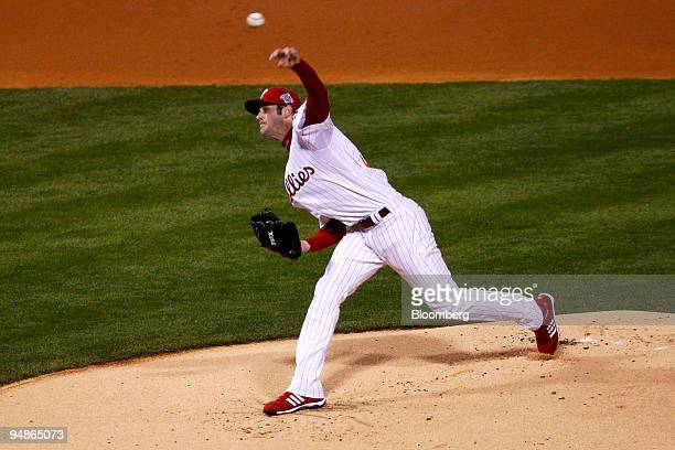 Cole Hamels of the Philadelphia Phillies throws the first pitch against the Tampa Bay Rays in the first inning of game five of the Major League...