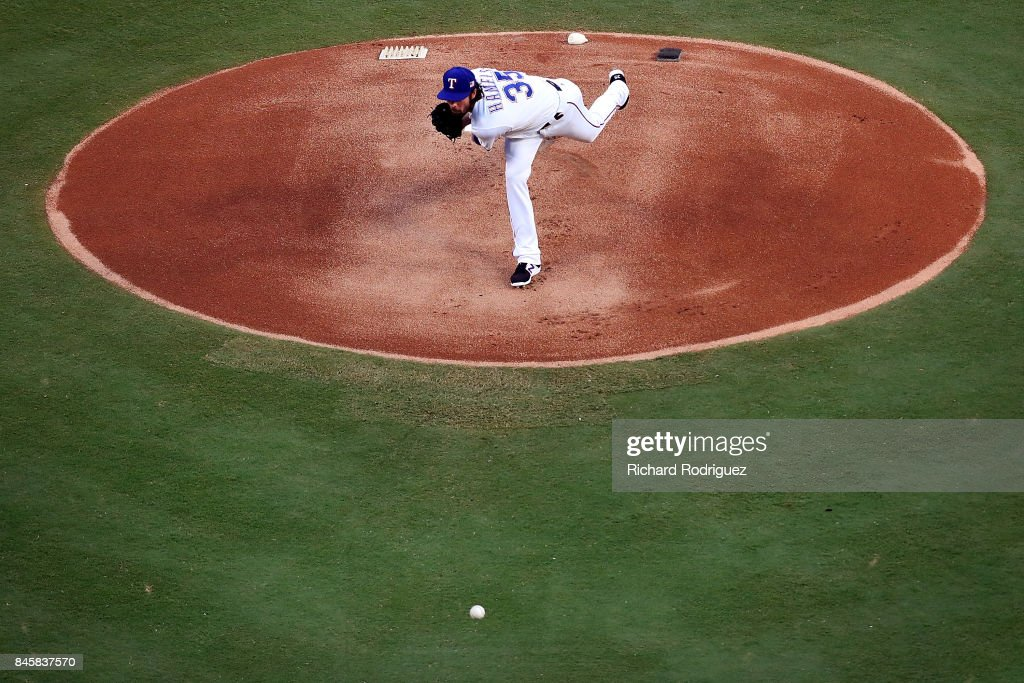 Cole Hamels #35 of the Texas Rangers delivers a pitch agaisnt the Seattle Mariners in the first inning at Globe Life Park in Arlington on September 11, 2017 in Arlington, Texas.