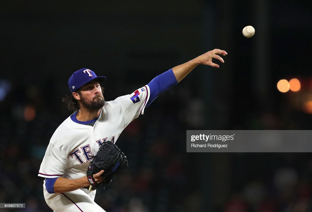 Cole Hamels #35 of the Texas Rangers delivers a pitch against the Seattle Mariners in the sixth inning at Globe Life Park in Arlington on September 11, 2017 in Arlington, Texas.