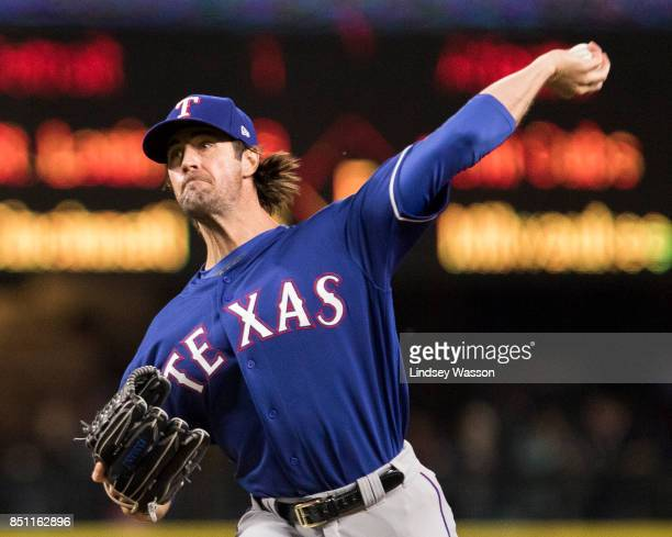 Cole Hamels of the Texas Rangers delivers against the Seattle Mariners in the first inning at Safeco Field on September 21 2017 in Seattle Washington...
