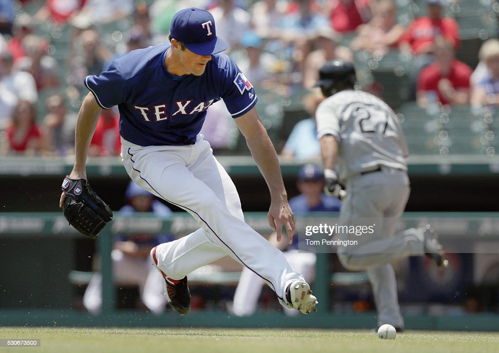 Cole Hamels #35 of the Texas Rangers fields a line drive against Dioner Navarro #27 of the Chicago White Sox in the bottom of the third inning at Globe Life Park in Arlington on May 11, 2016 in Arlington, Texas.