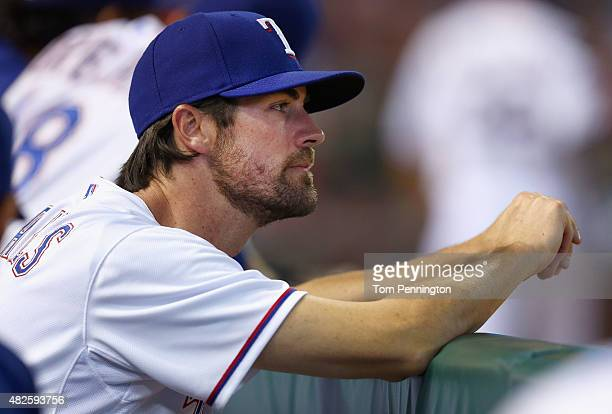 Cole Hamels of the Texas Rangers looks on as the Rangers take on the San Francisco Giants in the bottom of the eighth inning at Globe Life Park in...
