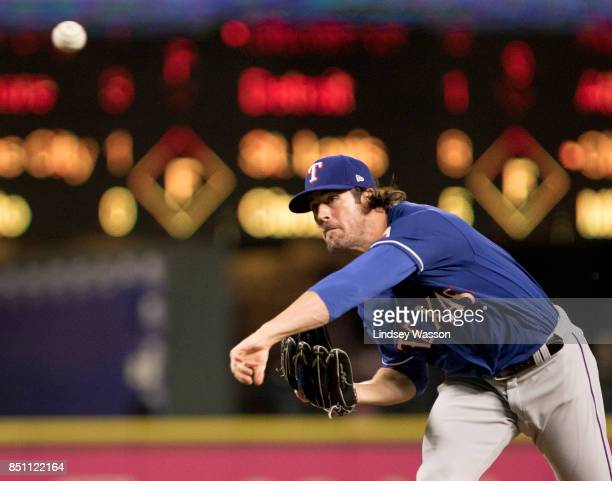 Cole Hamels of the Texas Rangers pitches against the Seattle Mariners in the first inning at Safeco Field on September 21 2017 in Seattle Washington
