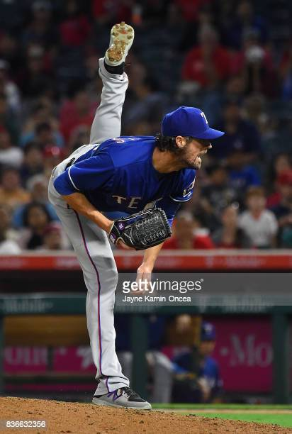 Cole Hamels of the Texas Rangers pitches in the sixth inning of the game against the Los Angeles Angels of Anaheim at Angel Stadium of Anaheim on...