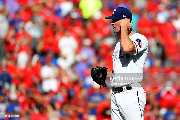 Cole Hamels of the Texas Rangers reacts against the Toronto Blue Jays during the third inning in game one of the American League Divison Series at...