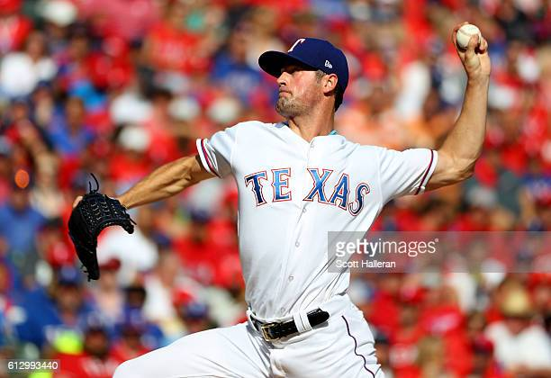 Cole Hamels of the Texas Rangers throws a pitch against the Toronto Blue Jays during the second inning in game one of the American League Divison...