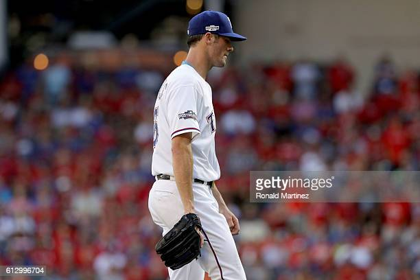 Cole Hamels of the Texas Rangers walks back to the dugout after being relieved during the fourth inning in game one of the American League Divison...