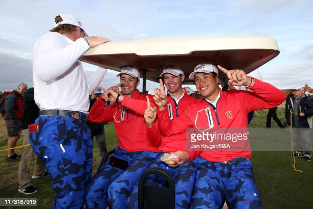 Cole Hammer, Alex Smalley and Isaiah Salinda of the United States celebrate their team's victory following the singles matches during Day 2 of the...