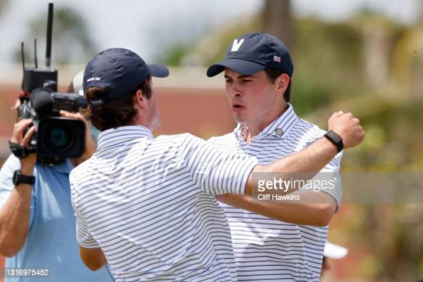 Cole Hammer and Davis Thompson of Team USA celebrate after Hammer made a putt to win their match during Day One of The Walker Cup at Seminole Golf...