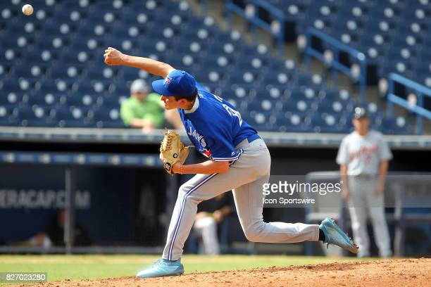 Cole Henry delivers a pitch to the plate during the East Coast Pro Showcase on August 04 at Steinbrenner Field in Tampa, FL.
