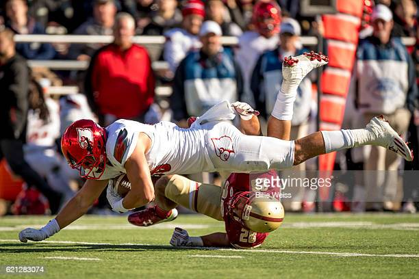 Cole Hikutini of Louisville dives above Matt Milano of Boston College during the third quarter of a game at Alumni Stadium on November 5 2016 in...