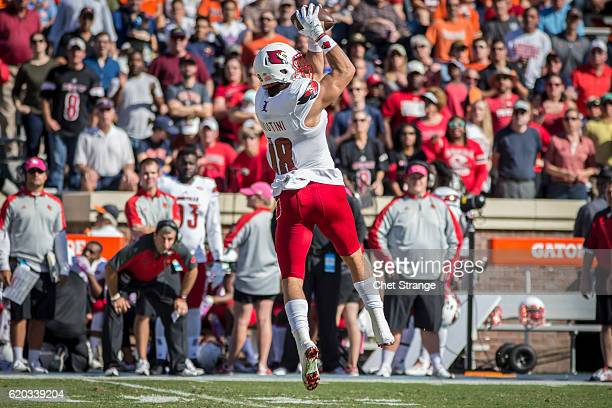 Cole Hikutini of the Louisville Cardinals pulls in a pass against the Virginia Cavaliers at Scott Stadium on October 29 2016 in Charlottesville...