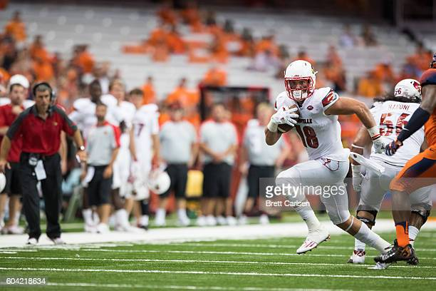 Cole Hikutini of the Louisville Cardinals runs with the ball during the second half against the Syracuse Orange on September 9 2016 at The Carrier...
