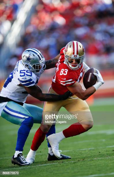 Cole Hikutini of the San Francisco 49ers gets tackled after making a reception during the game against the Dallas Cowboys at Levi's Stadium on...