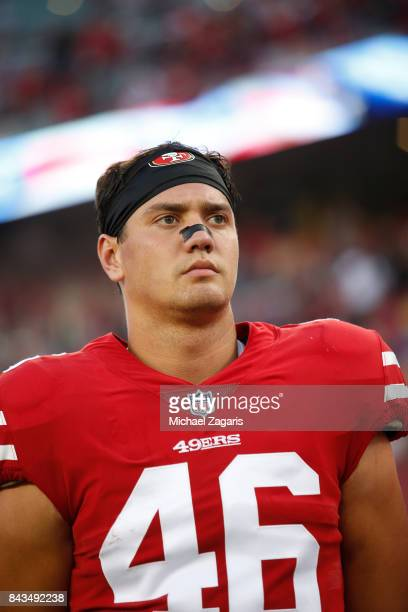 Cole Hikutini of the San Francisco 49ers stands on the sideline prior to the game against the Los Angeles Chargers at Levi's Stadium on August 31...