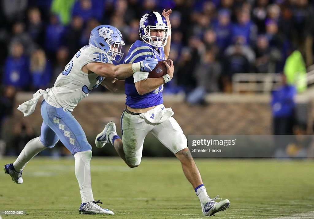 Cole Holcomb #36 of the North Carolina Tar Heels tries to stop Daniel Jones #17 of the Duke Blue Devils during their game at Wallace Wade Stadium on November 10, 2016 in Durham, North Carolina.