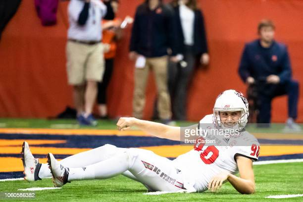 J Cole III of the North Carolina State Wolfpack reacts to Syracuse Orange being called for roughing the passer during the second quarter at the...