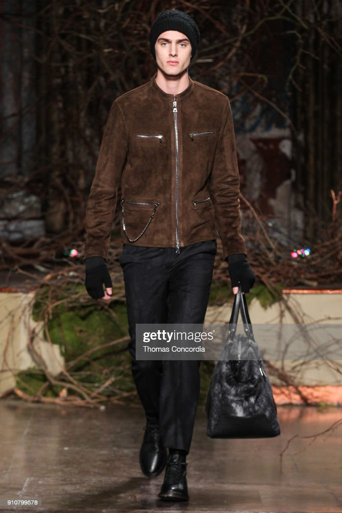 Cole James walks the runway wearing John Varvatos Fall/Winter 2018 with makeup by Chika Chan for Make-Up Pro and Hair by Yannik D'Is for Cultler/Redken at the Angel Orensanz Foundation on January 26, 2018 in New York City.