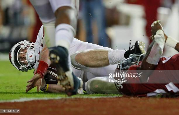 Cole Kelley of the Arkansas Razorbacks is sacked by Rashaan Evans of the Alabama Crimson Tide at BryantDenny Stadium on October 14 2017 in Tuscaloosa...