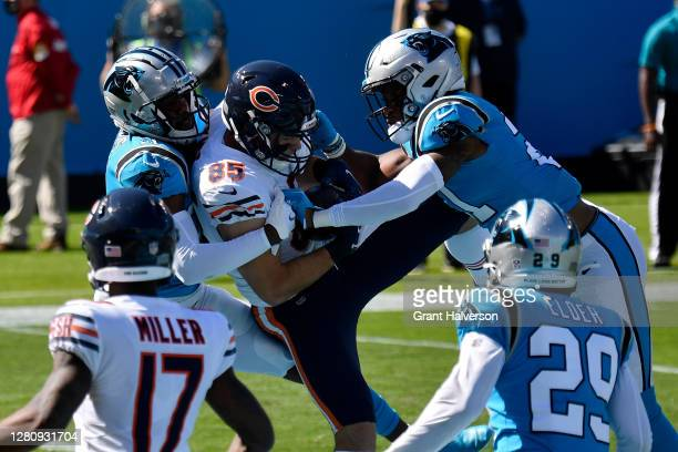 Cole Kmet of the Chicago Bears makes a touchdown catch between Juston Burris and Jeremy Chinn of the Carolina Panthers in the first quarter at Bank...
