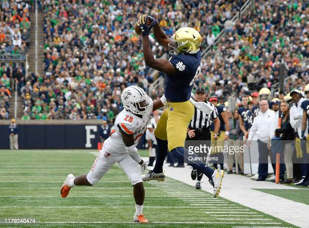 Cole Kmet of the Notre Dame Fighting Irish catches a pass in the first half against the Bowling Green Falcons at Notre Dame Stadium on October 05...