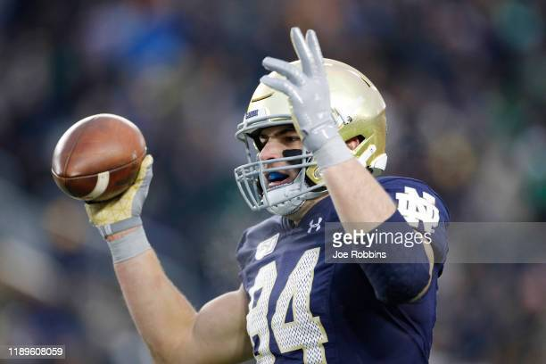 Cole Kmet of the Notre Dame Fighting Irish celebrates after an 11yard touchdown reception against the Boston College Eagles in the third quarter at...