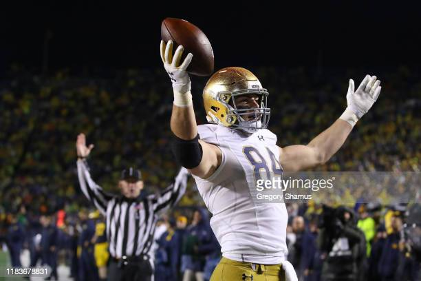 Cole Kmet of the Notre Dame Fighting Irish celebrates his second half touchdown against the Michigan Wolverines at Michigan Stadium on October 26,...