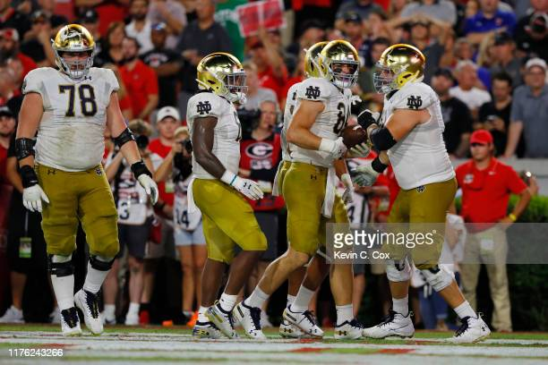 Cole Kmet of the Notre Dame Fighting Irish celebrates his second quarter touchdown with teammates while playing the Georgia Bulldogs at Sanford...