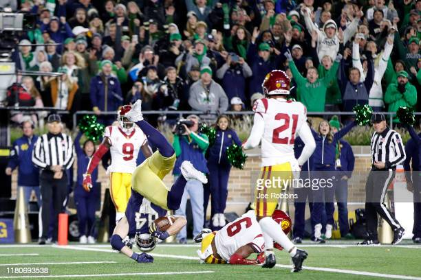 Cole Kmet of the Notre Dame Fighting Irish dives into the end zone for a 10yard touchdown in the second quarter against the USC Trojans at Notre Dame...