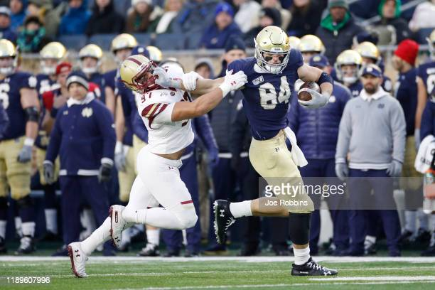 Cole Kmet of the Notre Dame Fighting Irish runs after catching a pass against Marcus Valdez of the Boston College Eagles in the second half at Notre...