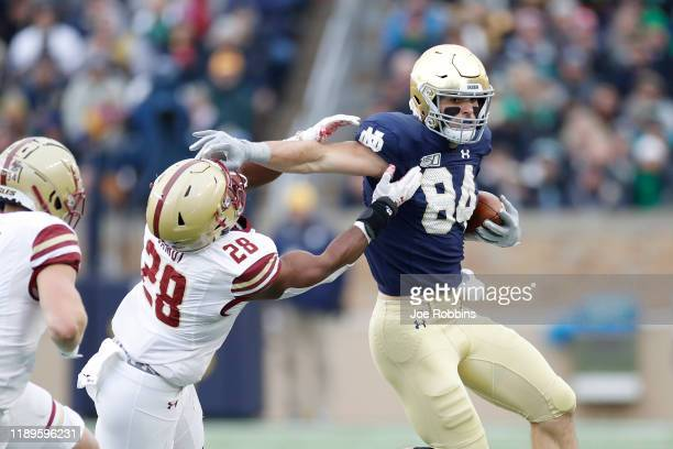 Cole Kmet of the Notre Dame Fighting Irish runs with the ball after a reception against John Lamot of the Boston College Eagles in the first quarter...
