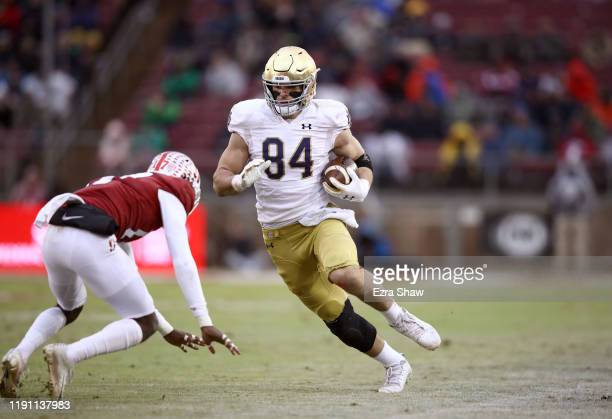 Cole Kmet of the Notre Dame Fighting Irish runs with the ball against the Stanford Cardinal at Stanford Stadium on November 30 2019 in Palo Alto...