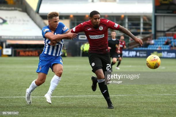 Cole Kpekawa of St Mirren battles with Eamonn Brophy of Kilmarnock FC during the Betfred Scottish League Cup match between Kilmarnock and St Mirren...