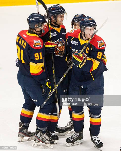 Cole Mayo, Connor McDavid, Dylan Strome and Alex DeBrincat of the Erie Otters celebrate a goal against the Windsor Spitfires on September 26, 2014 at...