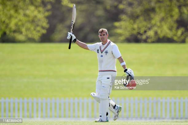 Cole McConchie of Canterbury celebrates his century during the Plunket Shield match between Canterbury and Northern Districts at Hagley Oval on...