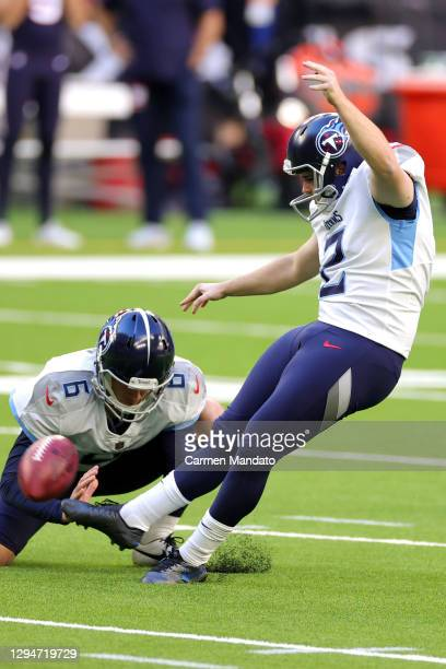 Cole McDonald and Brett Kern of the Tennessee Titans in action against the Houston Texans during a game at NRG Stadium on January 03, 2021 in...