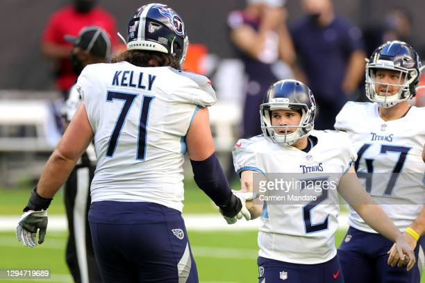 Cole McDonald and Dennis Kelly of the Tennessee Titans in action against the Houston Texans during a game at NRG Stadium on January 03, 2021 in...