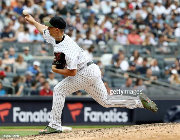 J Cole of the New York Yankees delivers a pitch in the seventh inning against the Houston Astros at Yankee Stadium on May 28 2018 in the Bronx...