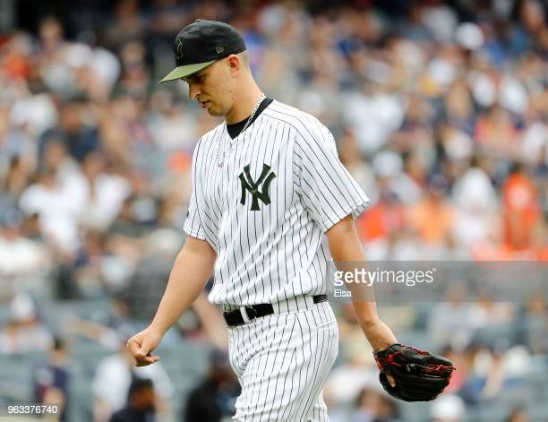 J Cole of the New York Yankees heads to the dugout in the seventh inning against the Houston Astros at Yankee Stadium on May 28 2018 in the Bronx...