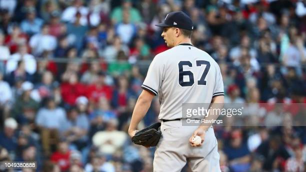 J Cole of the New York Yankees looks on before pitching in the bottom of the sixth inning of the game against the Boston Red Sox at Fenway Park on...
