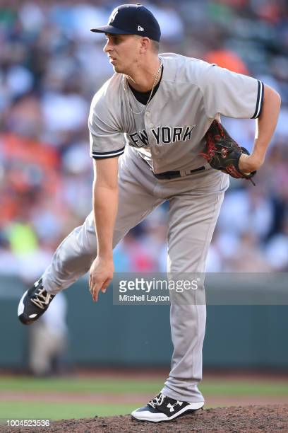 J Cole of the New York Yankees pitches during game one of a doubleheader baseball game against the Baltimore Orioles at Oriole Park at Camden Yards...