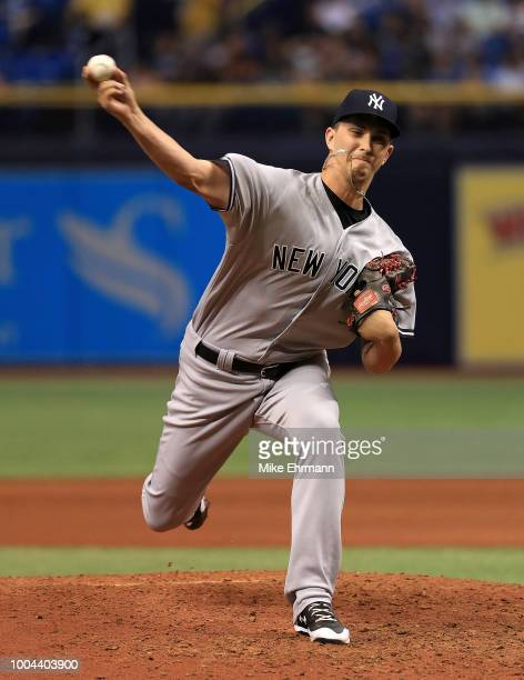 J Cole of the New York Yankees pitches in the eighth inning during a game against the Tampa Bay Rays at Tropicana Field on July 24 2018 in St...